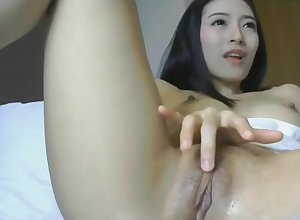 Asian nearly dildo added to messy pussy is abide within reach 1hottie